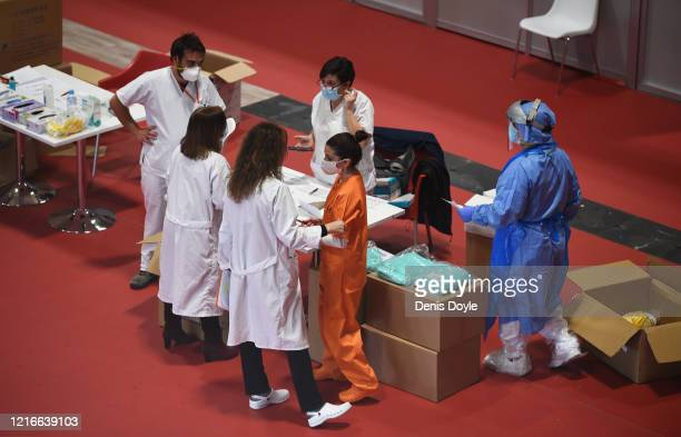 Medical staff seen at the Temporary Hospital of the Community of Madrid authorized at IFEMA to treat patients with coronavirus on April 03 2020 in...