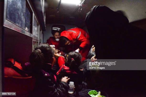 DOUMA DOUMA SYRIA DAMASCUS SYRIA Medical staff seen helping patients in an ambulance The evacuation of two wounded in the eastern Ghouta besieged the...