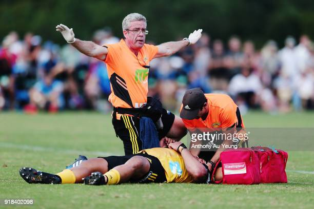 Medical staff signals a stretcher for Chris Eves of the Hurricanes after a head knock during the Super Rugby trial match between the Blues and the...