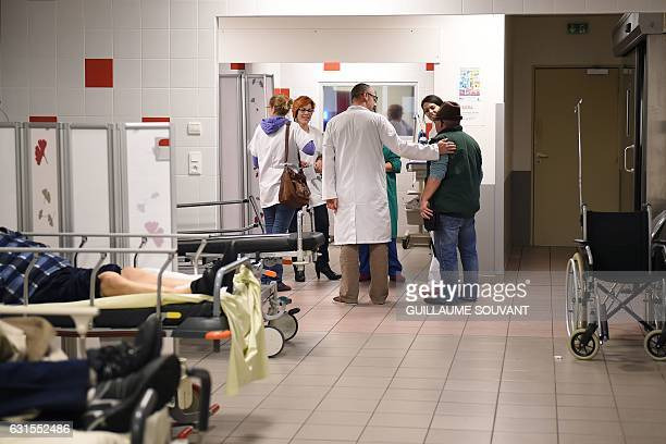 Medical staff speaks with patients at the emergency department of the hospital of Trousseau in Tours on January 12 2017 during a major flu epidemic...