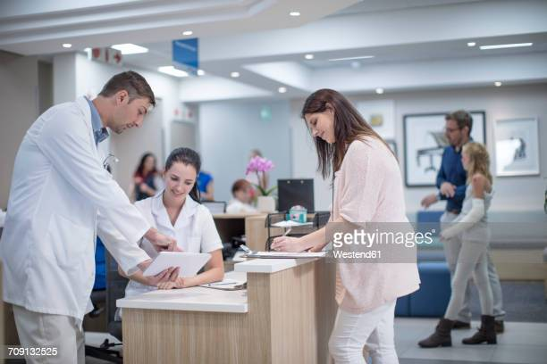 Medical staff standing in reception area