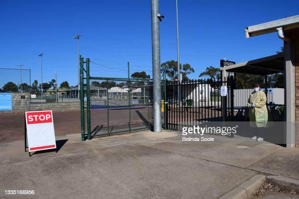 Medical staff stands watch outside a COVID-19 testing center on August 20, 2021 in Dubbo, Australia. Lockdown restrictions remain in place across...
