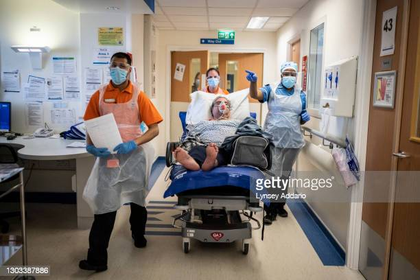 Medical staff Tahmid Chowdhury 22, and Helen Conkleton 41, transporting Ranghbir Hayer through the A&E section of the ward reserved for suspected...