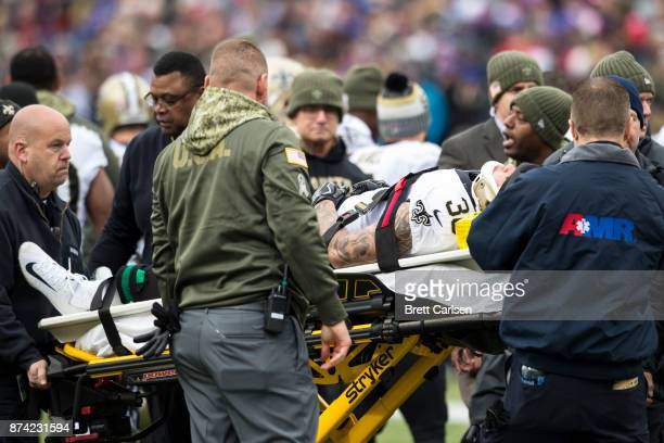 Medical staff takes Daniel Lasco of the New Orleans Saints off the field in an ambulance after colliding with Brandon Tate of the Buffalo Bills on a...