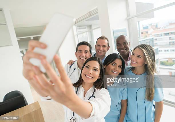Medical staff taking a selfie at the hospital