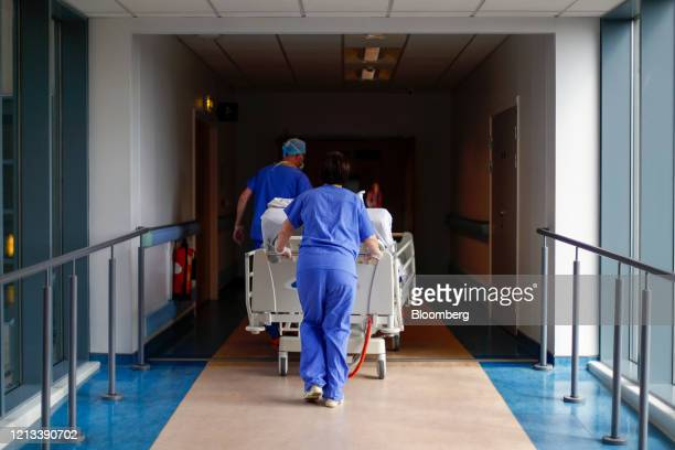 Medical staff transfer a patient along a corridor at The Royal Blackburn Teaching Hospital operated by East Lancashire NHS Trust in Blackburn UK on...