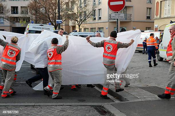 Medical staff transfer injured to local hospital from the site of this morning police raid on November 18, 2015 in Saint-Denis, France. French Police...
