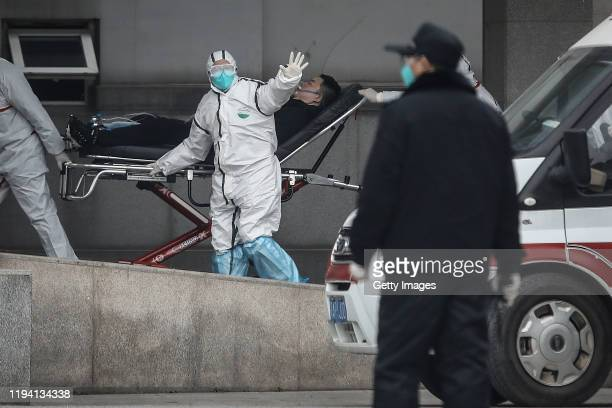 Medical staff transfer patients to Jin Yintan hospital on January 17, 2020 in Wuhan, Hubei, China. Local authorities have confirmed that a second...