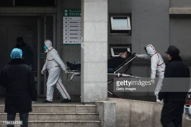 Medical staff transfer patients to Jin Yintan hospital on January 17 2020 in Wuhan Hubei China Local authorities have confirmed that a second person...