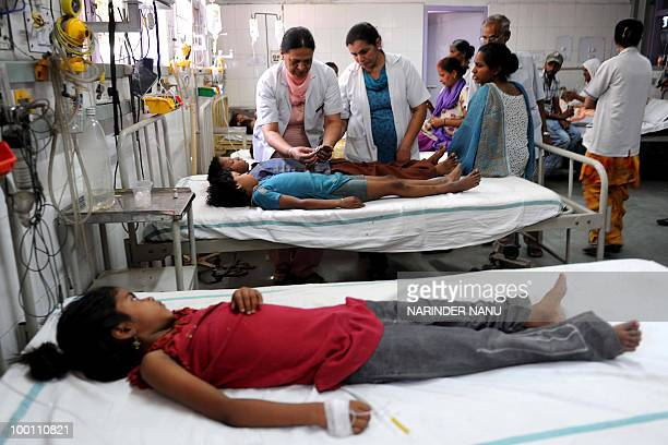 Medical staff treat students at the Civil hospital in Amritsar on May 21 after they took medicine of allegedly poor quality Twenty three students of...