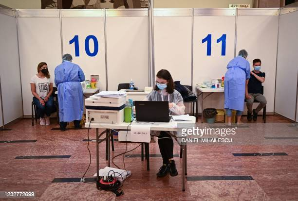 "Medical staff vaccinate resident during the vaccination marathon organized at the ""Bran Castle"" in Bran village on May 8, 2021. - Romanian..."