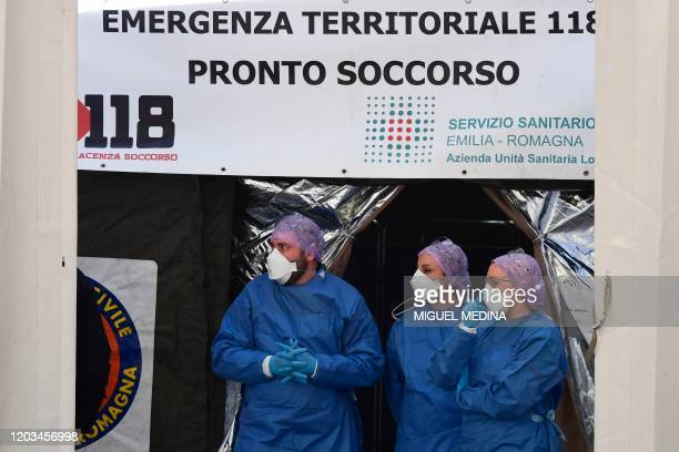 Medical staff wait outside a sanitary tent installed in Piacenza next to the hospital on February 26 2020 Italy saw a fresh jump in the number of...