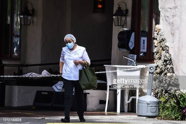 A medical staff walks out of Fair Havens Center nursing home facilities in Miami Springs on May 11 2020 Fair Havens Center reported 128 positive...