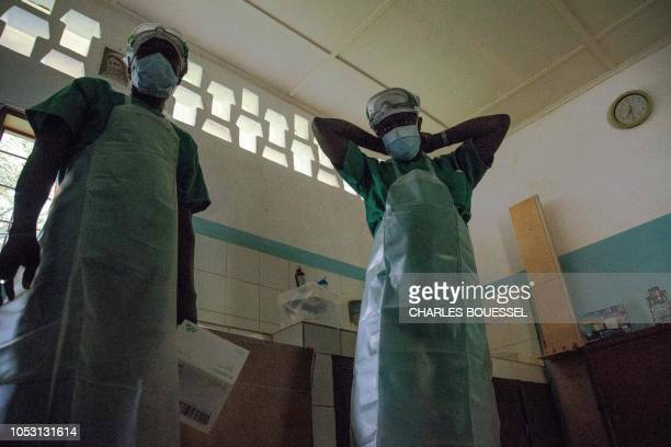 Medical staff wear protective equipments before entering the quarantine area of the centre of the International medical NGO Doctors Without Borders...