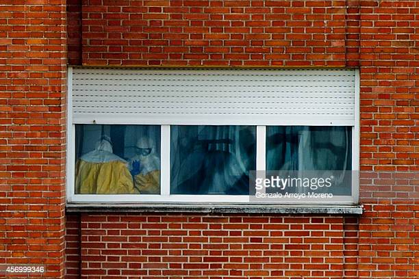 Medical staff wear protective suits inside Carlos III hospital where nurse Teresa Romero is being treated for the Ebola virus on October 10 2014 in...