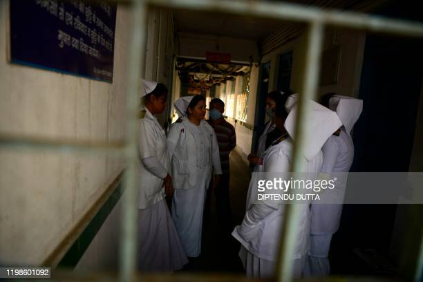 Medical staff wearing facemasks walk inside of an isolation ward opened as a preventative measure following a SARSlike virus outbreak which began in...