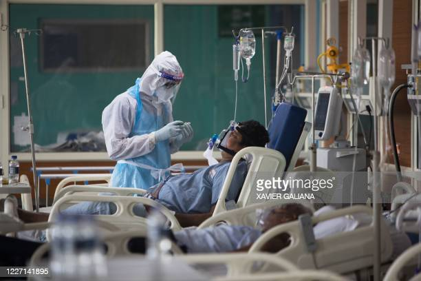 A medical staff wearing Personal Protective Equipment suit looks after a COVID19 coronavirus patient at the Intensive Care Unit of the Sharda...