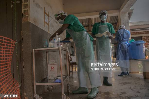 Medical staff wearing protective equipment enter the quarantine area of the centre of the International medical NGO Doctors Without Borders in Zomea...