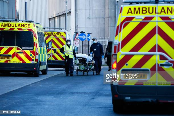Medical staff wheel a patient on a stretcher to an ambulance outside the emergency department of the Royal London Hospital in London, England, on...