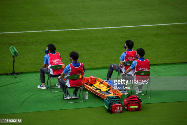 Medical staff with a stretcher on stand-by during an opening round women's football match between the U.S. And Sweden at the Tokyo 2020 Olympic Games...