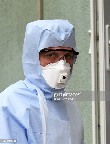 A medical staff with protective mask and suit walks at Dr Fran Mihaljevic hospital for Infectious Diseases in Zagreb on February 25 2020 where a...