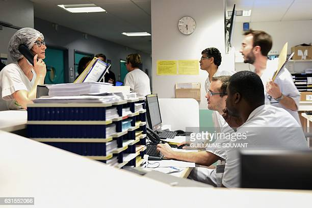 Medical staff work at the emergency department of the hospital of Trousseau in Tours on January 12 2017 during a major flu epidemic in France French...