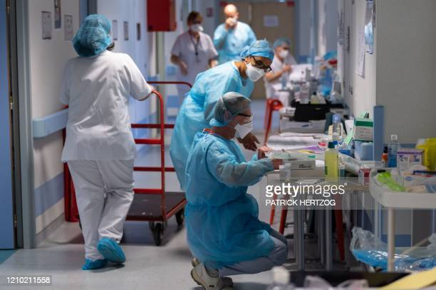Medical staff work in an especially created Post Resuscitation Unit for COVID-19 infected patients on April 17, 2020 at the Emile Muller hospital in...