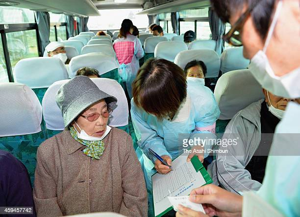 Medical staffs check the process during an evacuation drill on November 22 2014 in Tamura Fukushima Japan Fukushima prefecture hold the first...