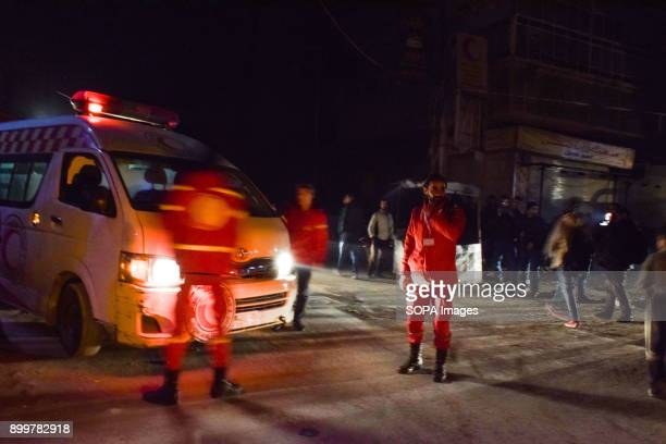 DOUMA DOUMA SYRIA DAMASCUS SYRIA Medical staffs seen outside the ambulance The evacuation of two wounded in the eastern Ghouta besieged the hospitals...