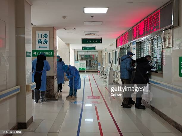Medical staffs sterilize the main building of Jinyintan Hospital on January 22 2020 in Wuhan China Flights trains and public transport including...