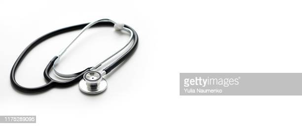 medical stethoscope for checking pulse, isolated on white background. medical concept. close up, plase for text. - stethoscope stock pictures, royalty-free photos & images
