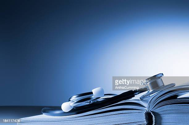 medical stethoscope on open book with copy space - textbook stock pictures, royalty-free photos & images