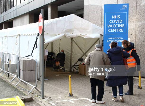 Medical steward checks in people into the vaccination centre. A steady stream of elderly people with pre-booked appointments at the new Covid-19...
