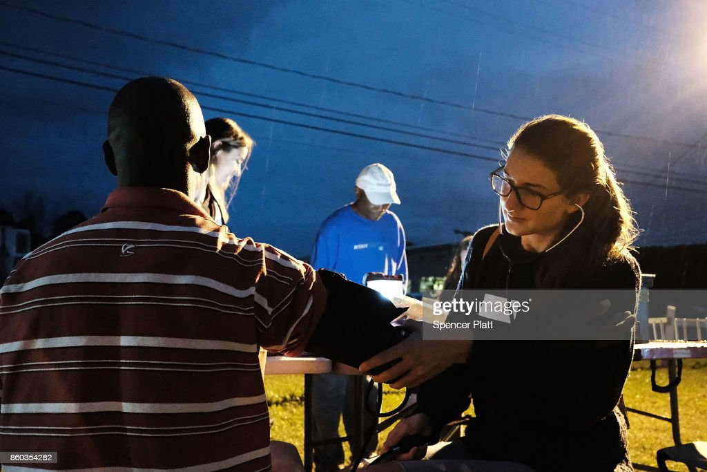 A medical student gives a check-up to a Jamaican migrant worker on a H2A visa at a Connecticut apple orchard and farm on October 11, 2017 in Middlefield, Connecticut. The University of Connecticut Migrant Farm Worker Clinics visit area farms and nurseries from June to October offering health screenings and preventive health education for migrant farm workers and their families. There are an estimated 3.5 million migrant and seasonal farm workers in the United States according to the United States Public Health Service. Many of these workers lack access to health professionals due to language barriers, a lack of transportation and fears of deportation.
