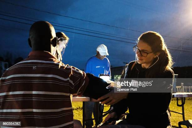 A medical student gives a checkup to a Jamaican migrant worker on a H2A visa at a Connecticut apple orchard and farm on October 11 2017 in...