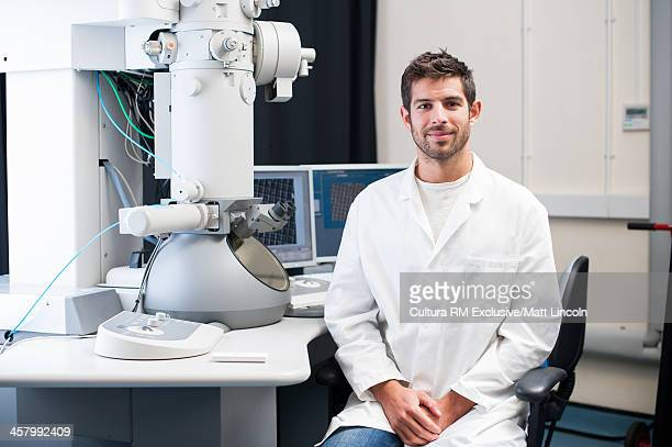 Medical student sitting at desk in laboratory