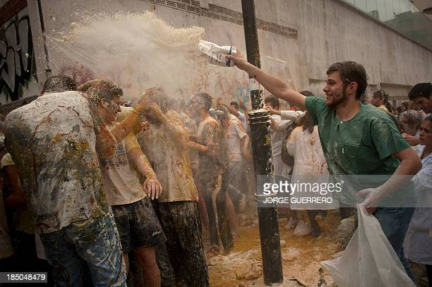 A medical student throws flour on freshers of the Faculty of Medicine during a hazing at the University of Granada in Granada on October 17 2013 AFP...