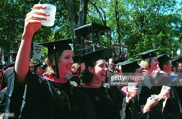 Medical students Erica Mayer left and Lucy Martin get ready to toast their graduating class June 8 2000 by drinking samples of warm wine during...