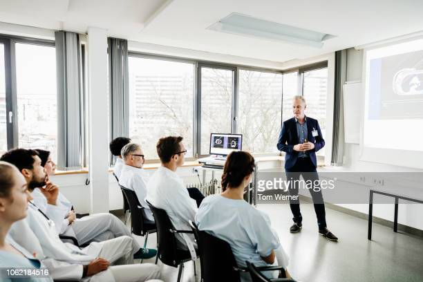 medical students focussing during seminar - vortrag stock-fotos und bilder