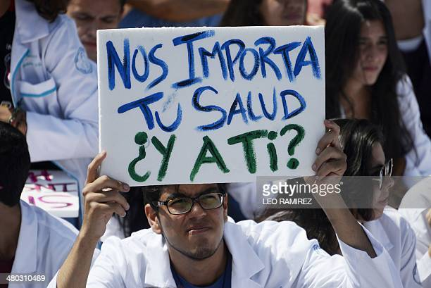 Medical students from the Venezuelan Central University attend an open air masterclass at a square as a protest for the lack of medical supplies in...