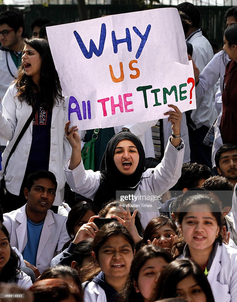 Medical students raise slogans and hold placards during a protest against the Medical Council Of India decision on adding 2 years in Medical courses, at Nirman Bhawan on February 12, 2014 in New Delhi, India. There is a proposal for increasing the duration of the MBBS course from the existing 5.5 years to 6.5 years with the addition of a compulsory one-year rural posting for admission into post-graduate programmes.