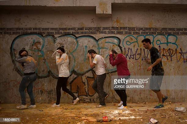 Medical students throw food at freshers of the Faculty of Medicine during a hazing at the University of Granada in Granada on October 17 2013 AFP...