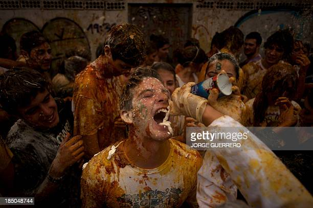 Medical students throw food on freshers of the Faculty of Medicine during a hazing at the University of Granada in Granada on October 17 2013 AFP...