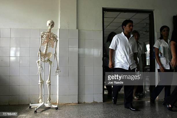 Medical students walk from a class room as they attend the Latin American School of Medical Sciences December 4 2006 in Havana Cuba Students study at...