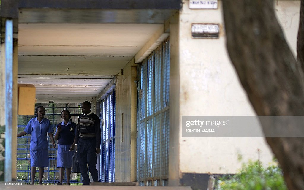 Medical students walk inside the Mathari hospital on May 13, 2013 in Nairobi. Kenyan police have launched a manhunt for 40 mentally ill patients who escaped from a psychiatric hospital in the capital Nairobi, officials said Monday. The patients overpowered guards and forced open the door of their ward in the Mathari Mental Hospital on Sunday morning, said local police chief Samuel Anampiu. At least 35 others were stopped by guards from leaving after the initial breakout. The hospital lies close to the sprawling Mathare slum district of Nairobi.