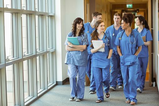 Medical students walking through corridor 532394887