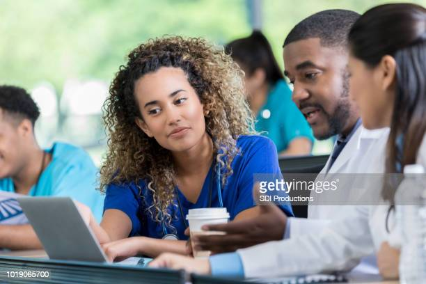 medical students work on a project together - classroom stock pictures, royalty-free photos & images