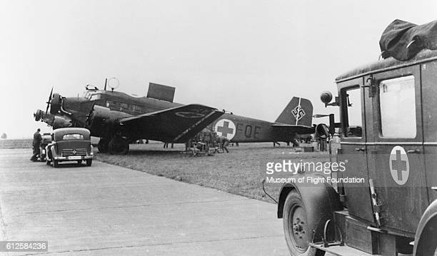 Medical supplies are being loaded into two German Air Force Junkers JU52/3M ambulance planes during World War II