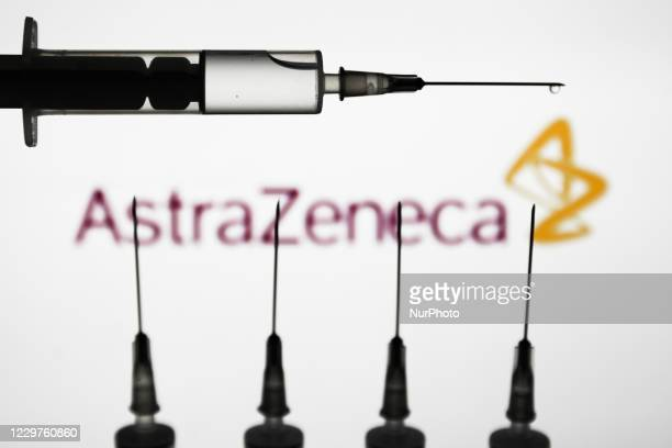 Medical syringes are seen with AstraZeneca logo displayed on a screen in the background in this illustration photo taken in Poland on November 23,...