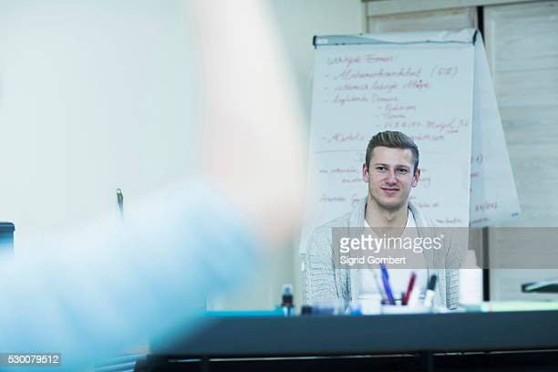 medical teacher sitting in his office and student in foreground, freiburg im breisgau, baden-w��rttemberg, germany - sigrid gombert stock pictures, royalty-free photos & images